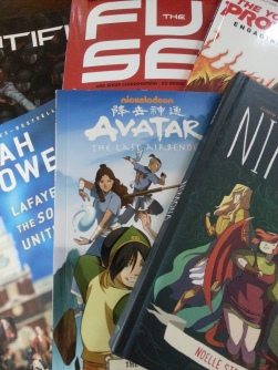 Image of comic books and novels.