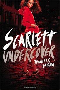 Teenage girl in red hooded sweatshirt.
